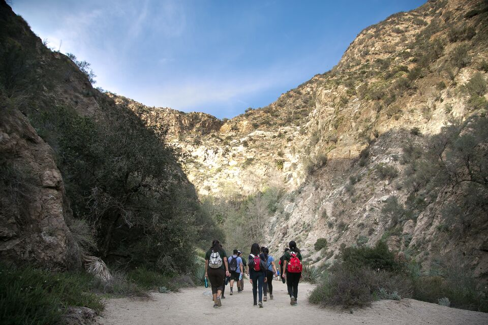 A group of hikers walks into a Southern California canyon.